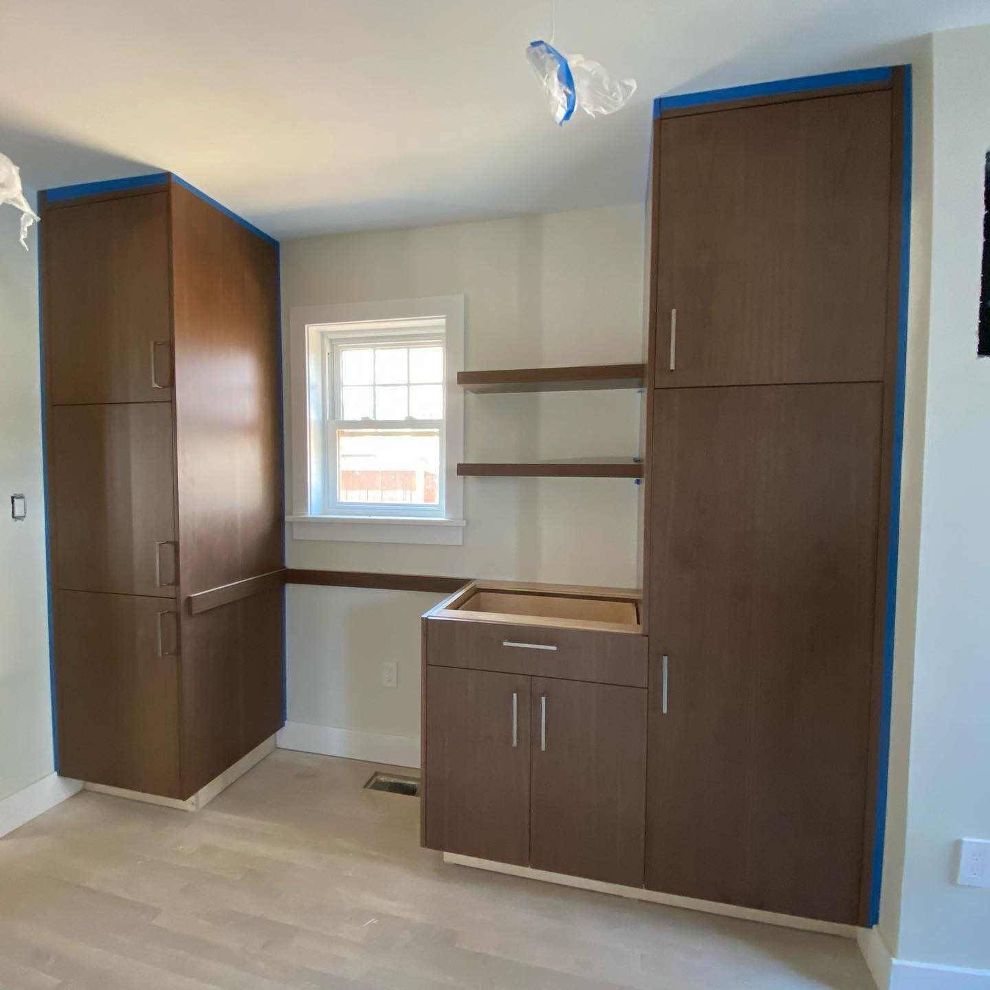 Walnut custom modern cabinets. Designed, built and installed by