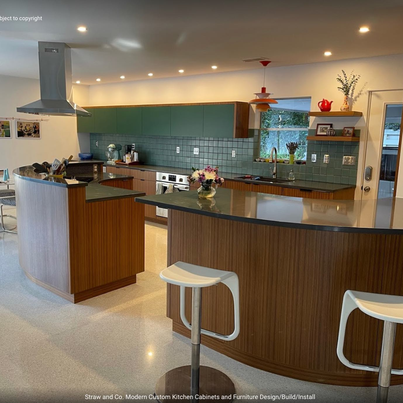 Client just sent us a couple of shots of their new teak kitchen. This is a super home. I look forward to having it professionally shot and including it in the portfolio. Curved back  and face cabinets, quarter sawn teak, matched and sequenced grain.