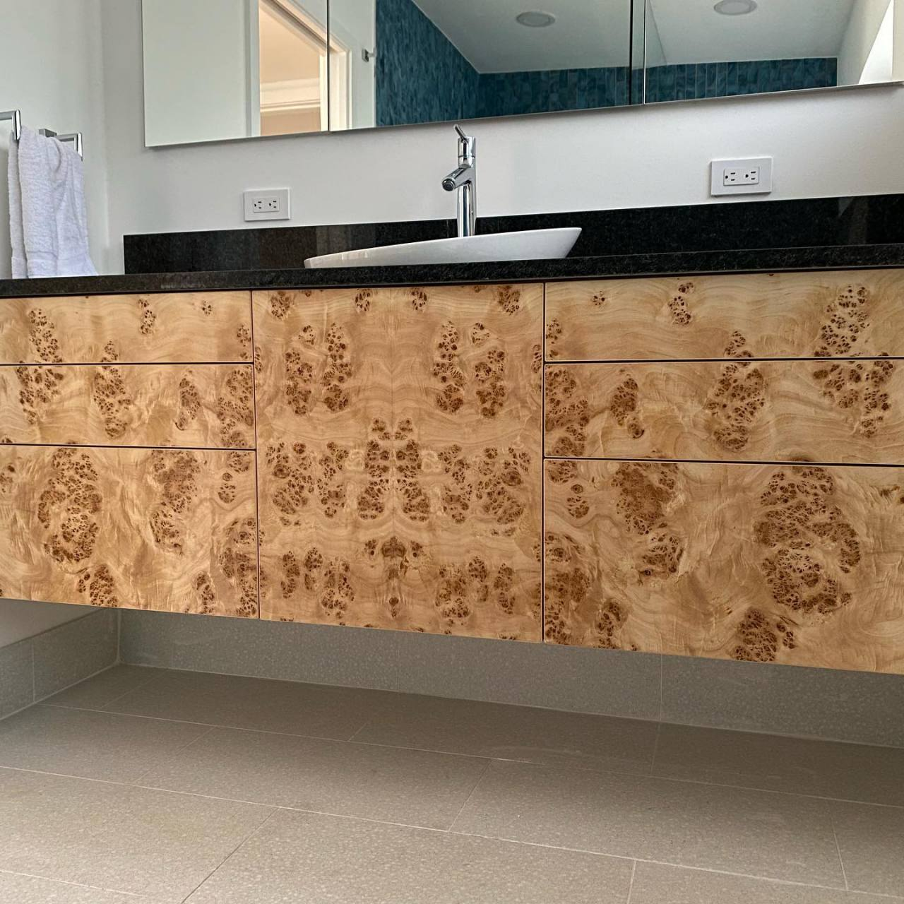 Maple burl and curly maple vanities.